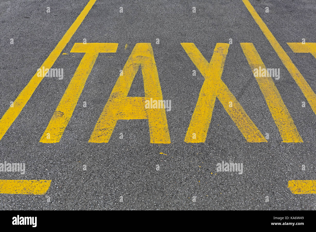Yellow Taxi Parking Sign at Street - Stock Image