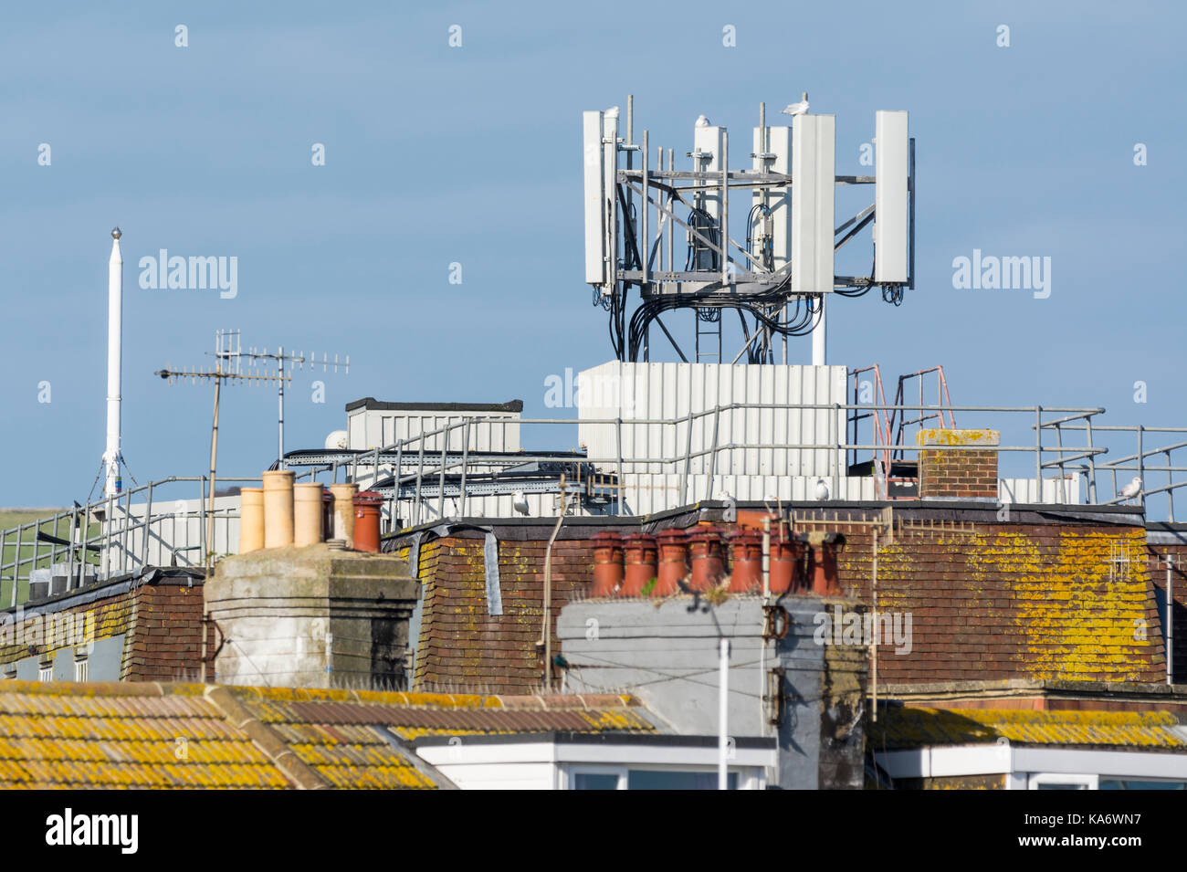 Mobile phone masts in the UK. Cell tower antennas for mobile network in the UK. - Stock Image