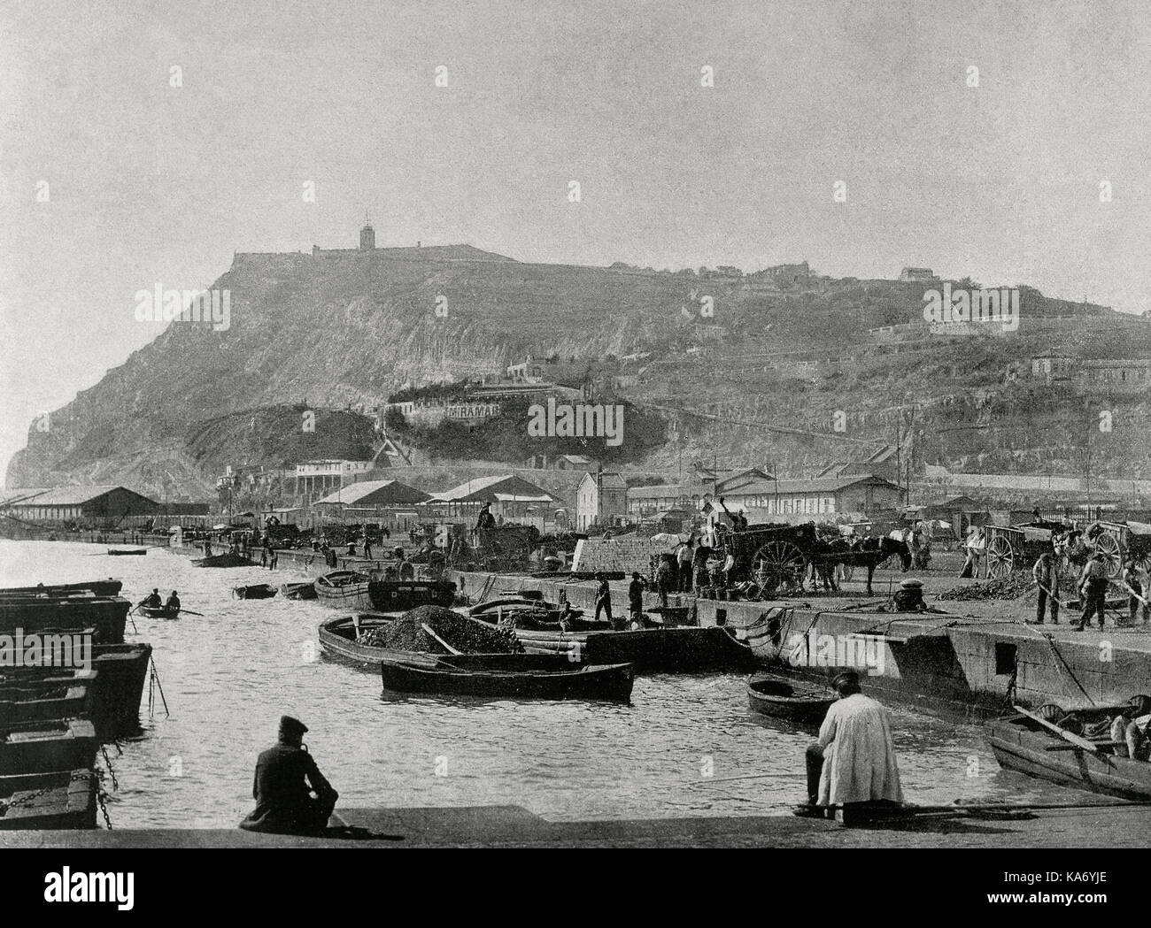 Spain. Catalonia. Barcelona. Coal's pier and Montjuic's Mountain in the background. Late 19th century. Photography. - Stock Image