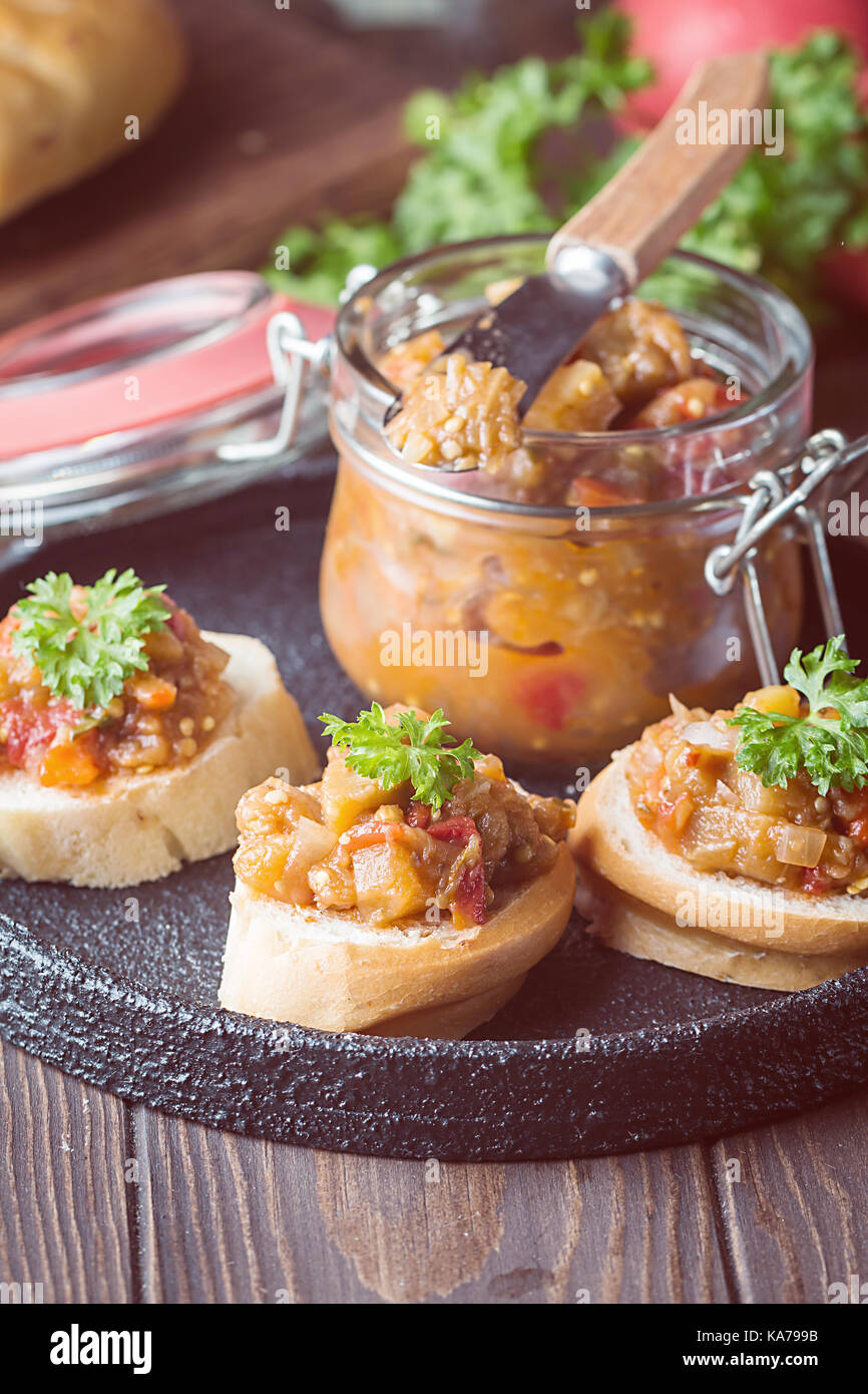 Bread toasts with eggplant caviar. - Stock Image