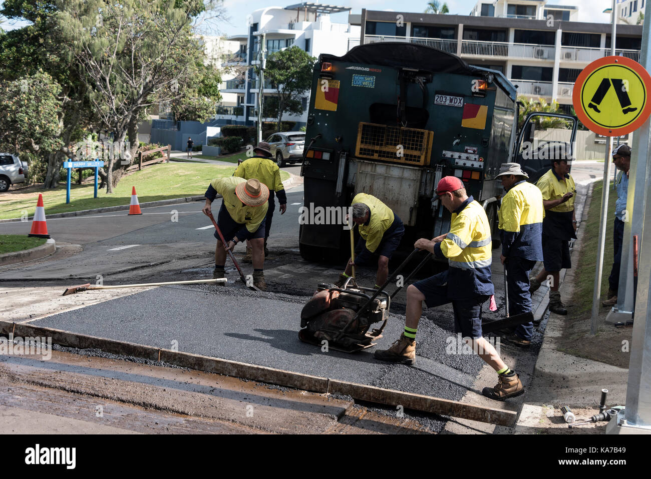 A road maintenance crew re-surfacing a road in Caloundra, Queensland, Australia - Stock Image