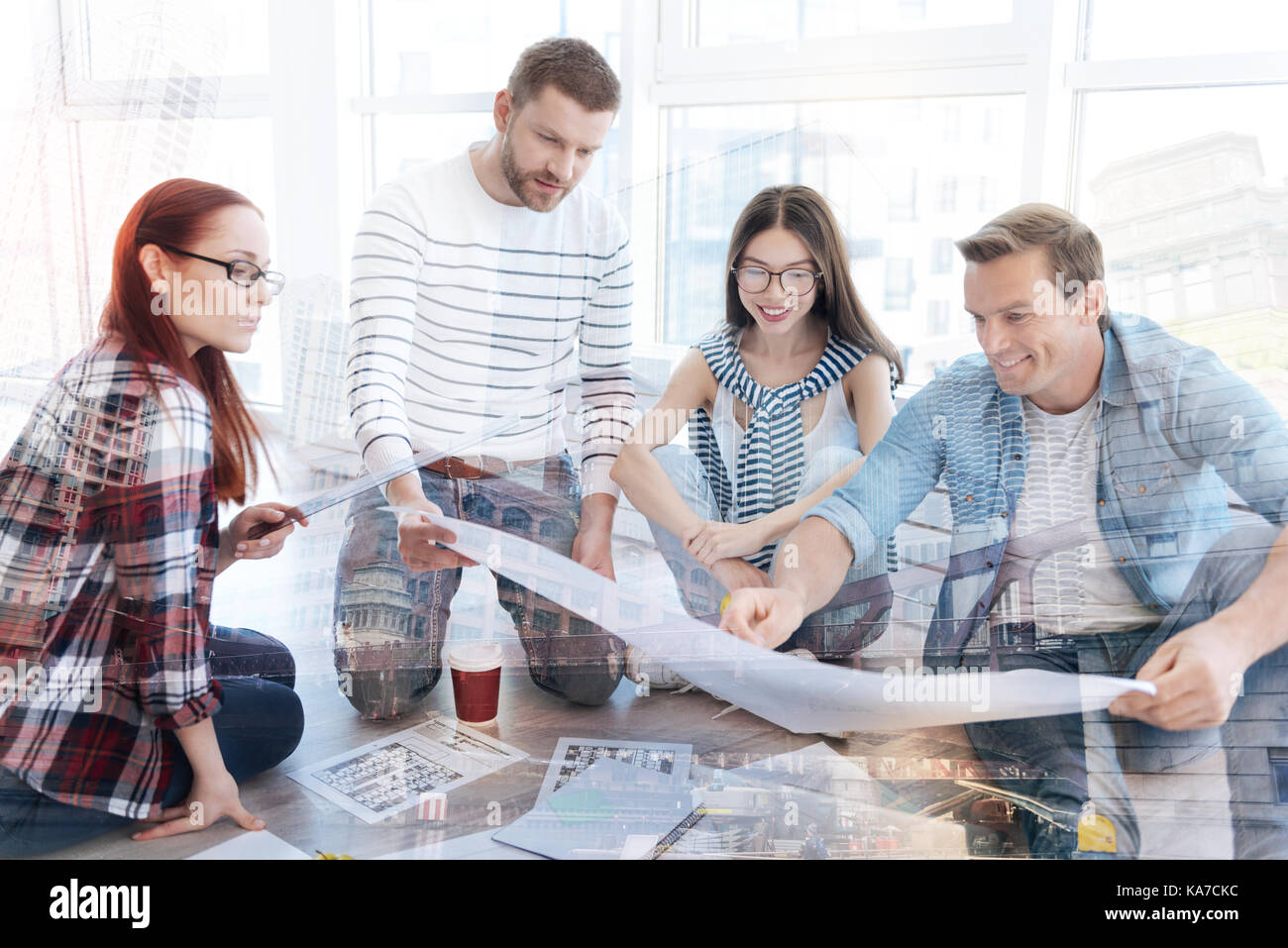 Interested coworkers looking at the sketch - Stock Image