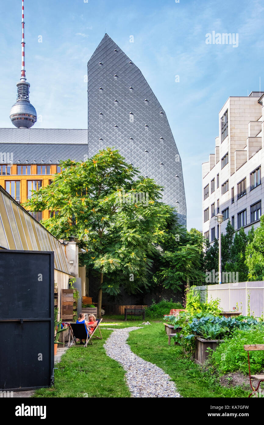 Berlin-Mitte. Berlin Water Company headquarters, Berliner Wasser Holding AG building lll, and community garden - Stock Image