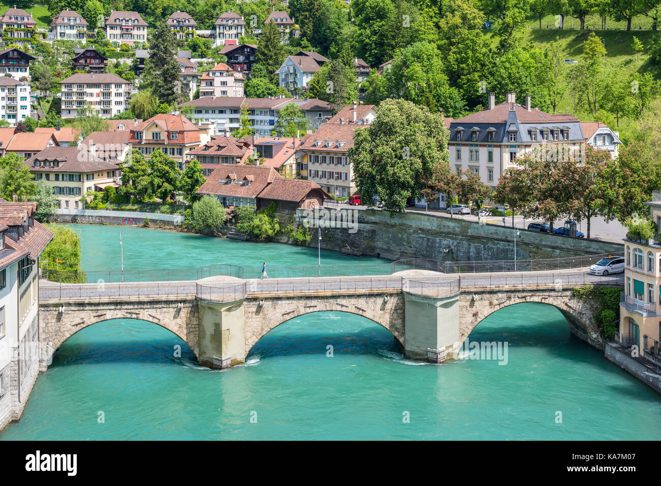 Bern, Switzerland - May 26, 2016: Architecture of the old European town, coastal cityscape with river and bridge Stock Photo
