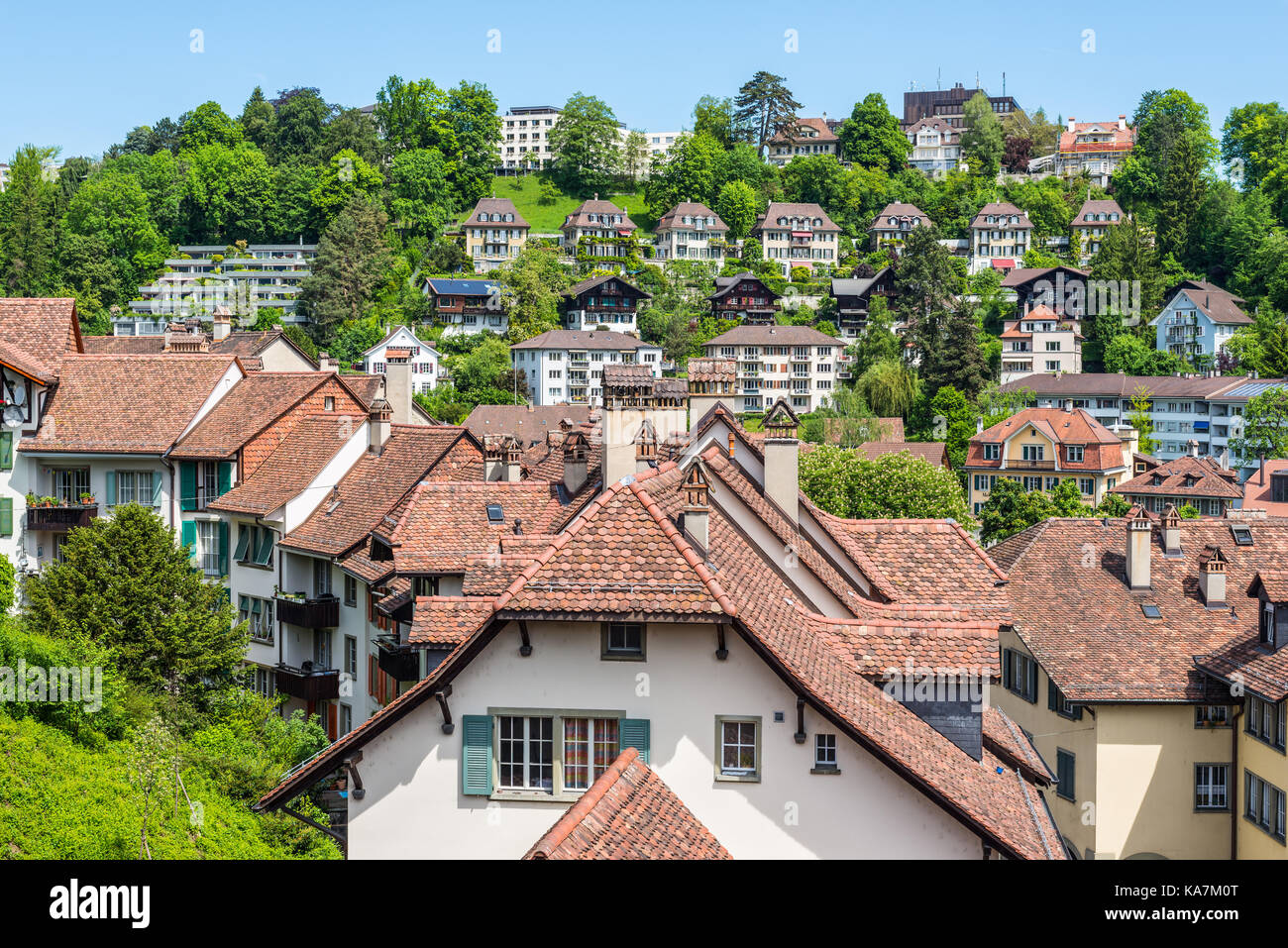 Bern, Switzerland - May 26, 2016: Architecture of the old European town and medieval tiled roof in Bern (Unesco Stock Photo
