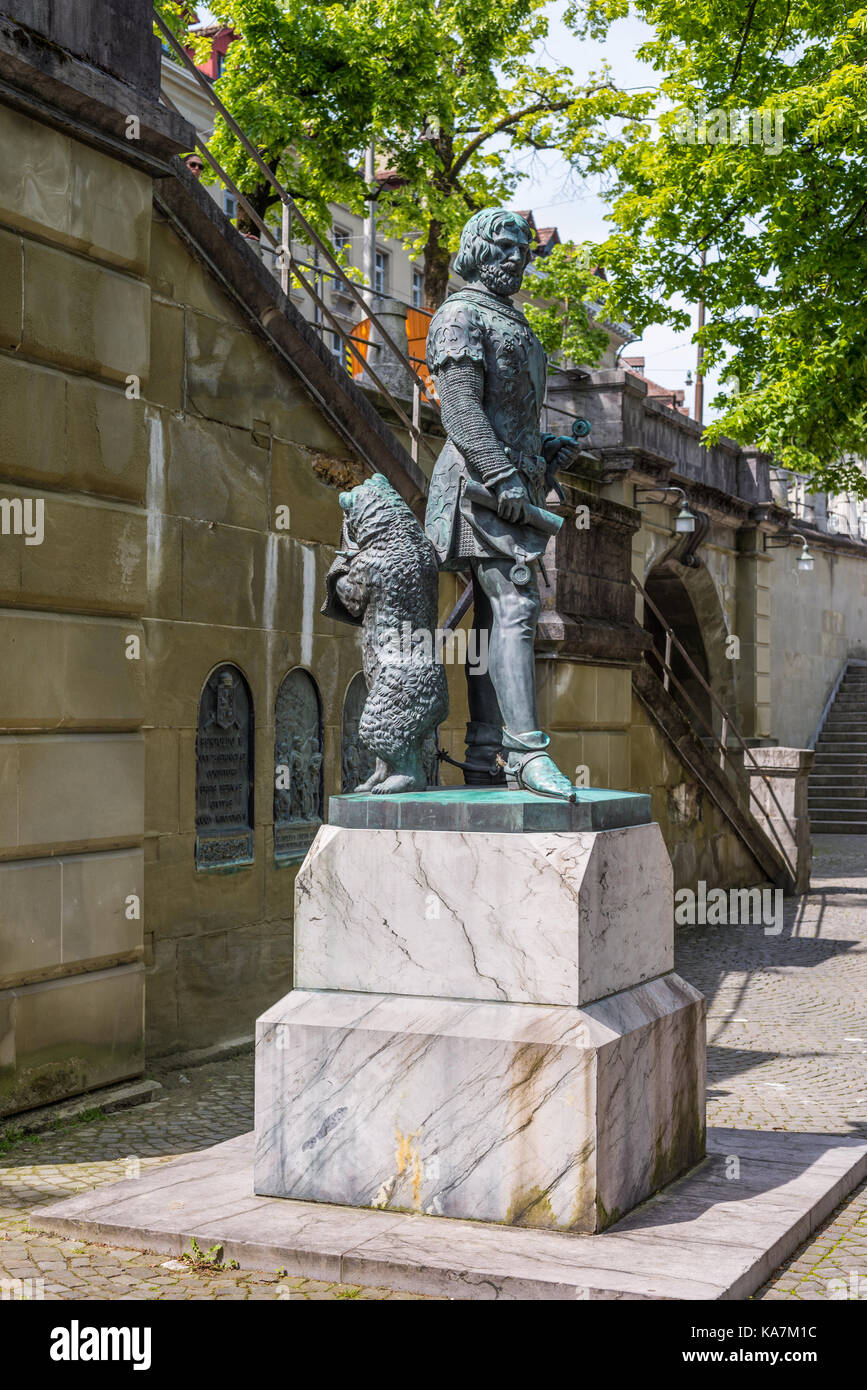 Bern, Switzerland - May 26, 2016: The bear, that is the city symbol, stands behind the founder of Bern, at Zahringer Stock Photo