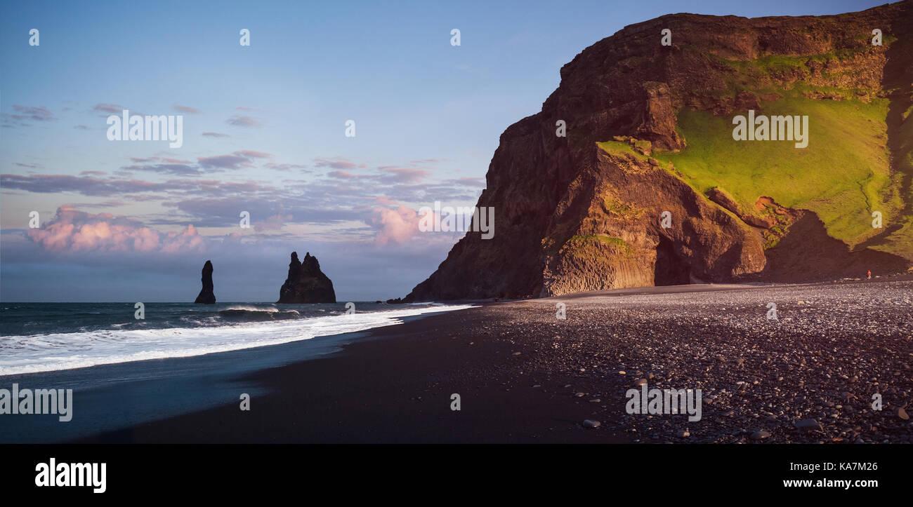 Famous Reynisdrangar rock formations at black Reynisfjara Beach. Coast of the Atlantic ocean near Vik, southern - Stock Image