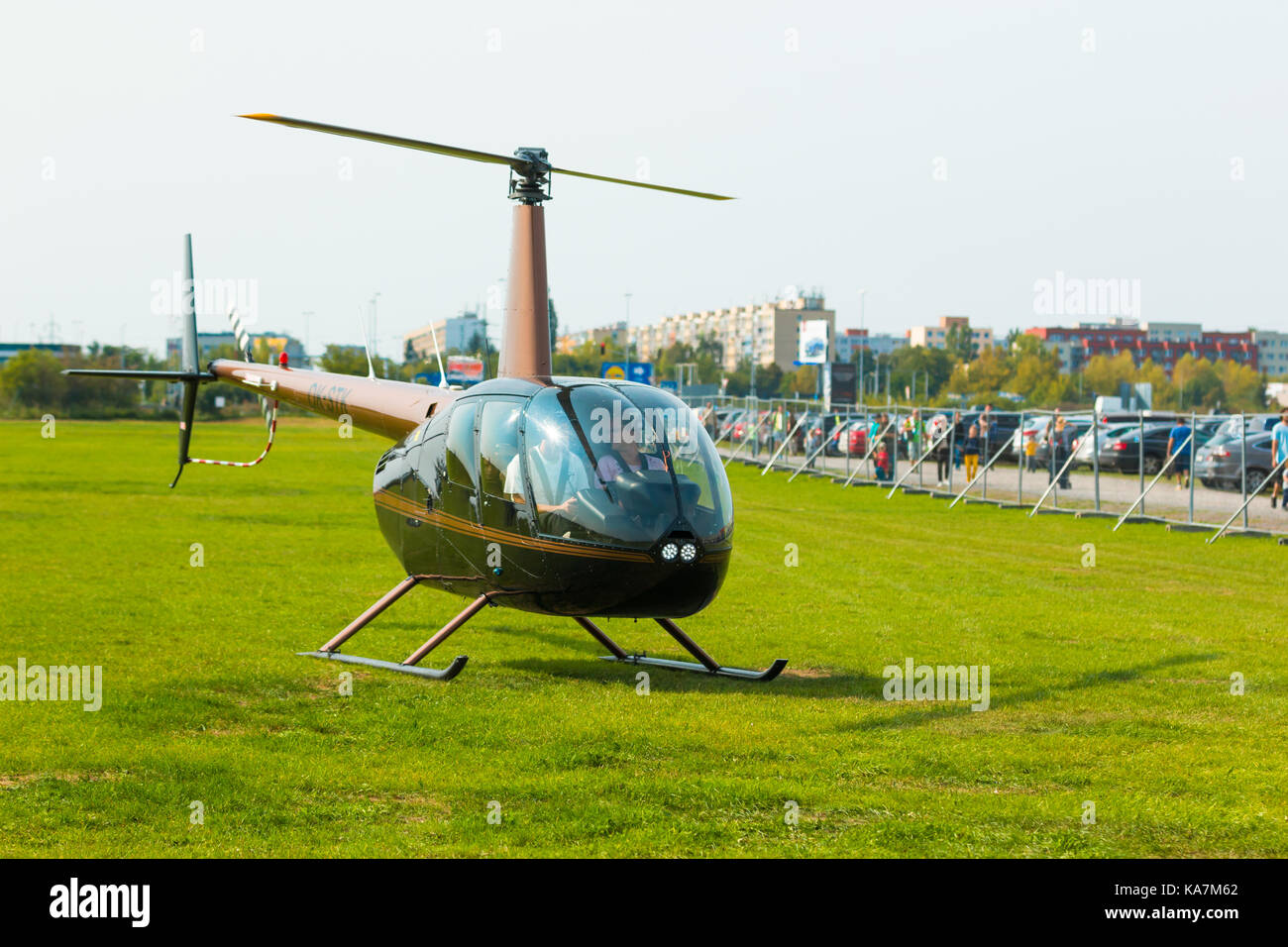 PRAGUE, CZECH REPUBLIC - 9.09.2017: New black helicopter use like business transportation, People in helicopter - Stock Image