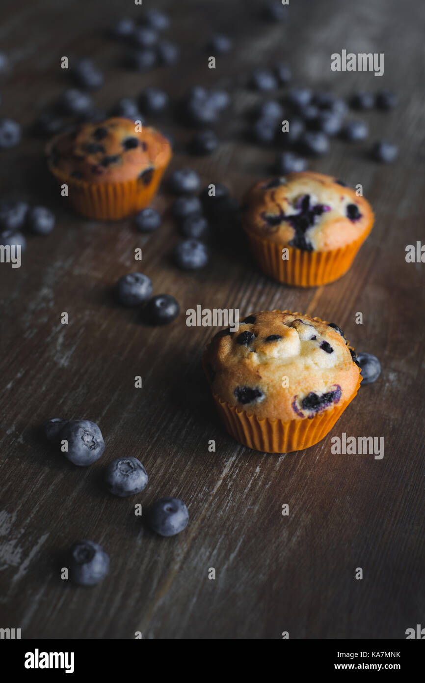 delicious cupcakes with blueberries - Stock Image