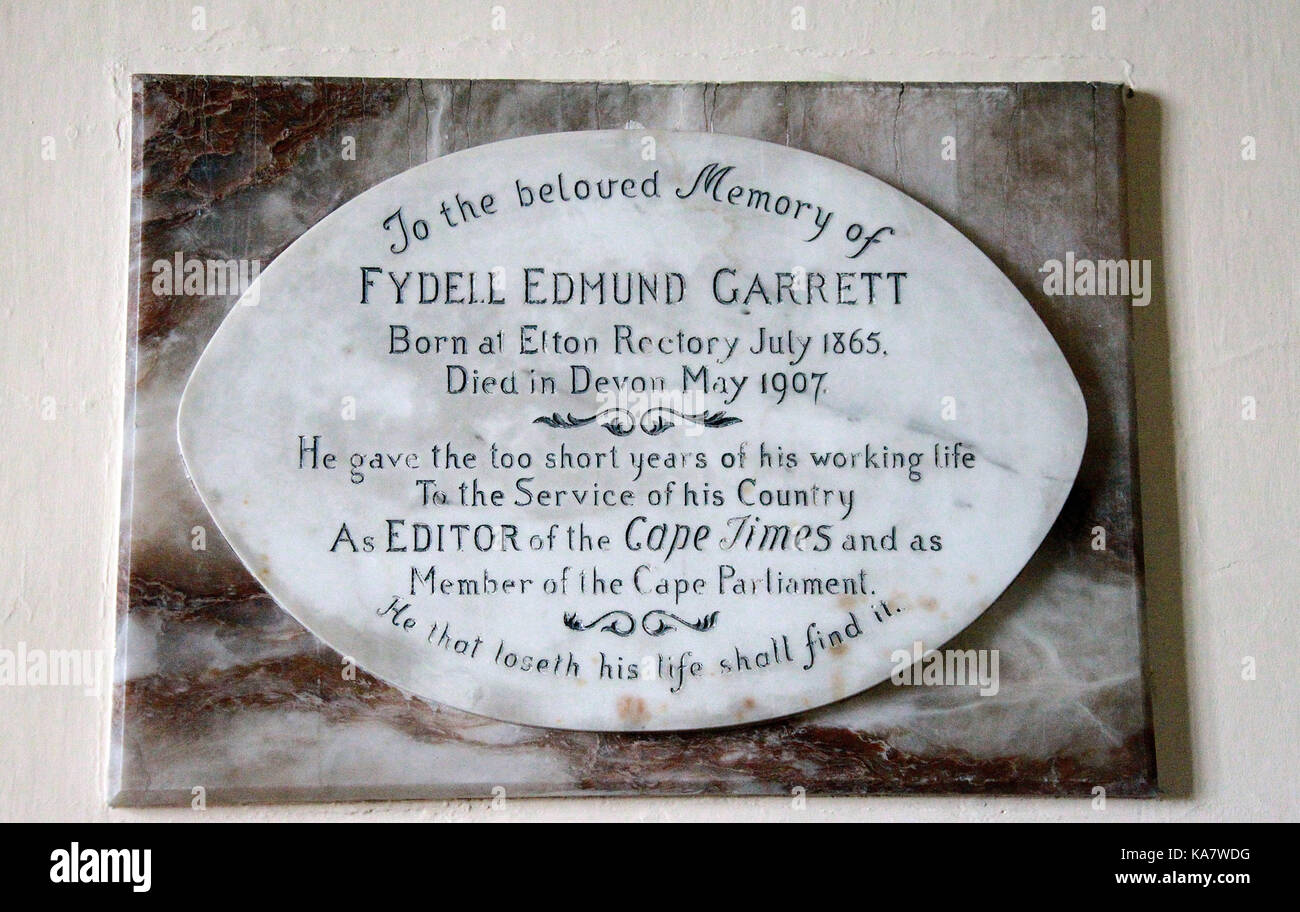Memorial plaque at All Saints Parish Church in Elton to Fydell Edmund Garrett - Stock Image