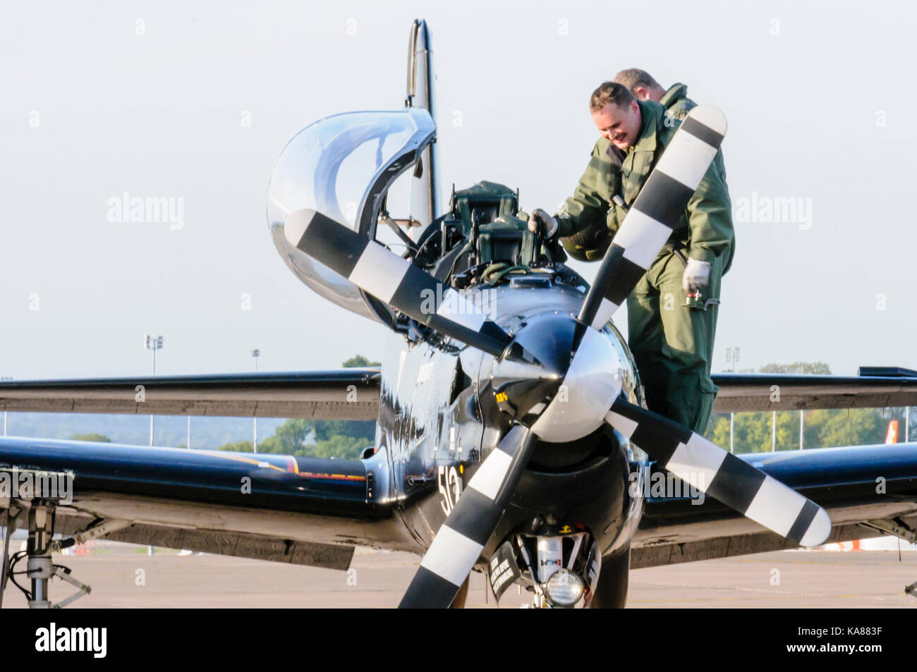 RAF Aldergrove, Northern Ireland. 25/09/2017 - Pilot and trainee disembark a Tucano training aircraft from 72 (R) - Stock Image