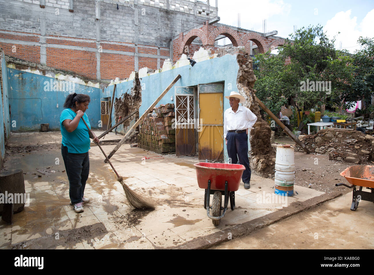 Judith Banda Perez, 50 and her father Timotheo Banda Morales, 82 stand in their demolished house after a earthquake - Stock Image