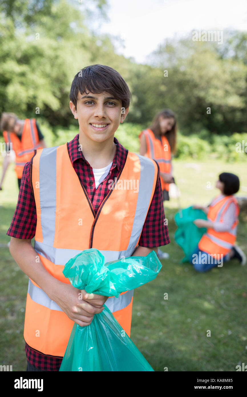 Group Of Helpful Teenagers Collecting Litter In Countryside - Stock Image
