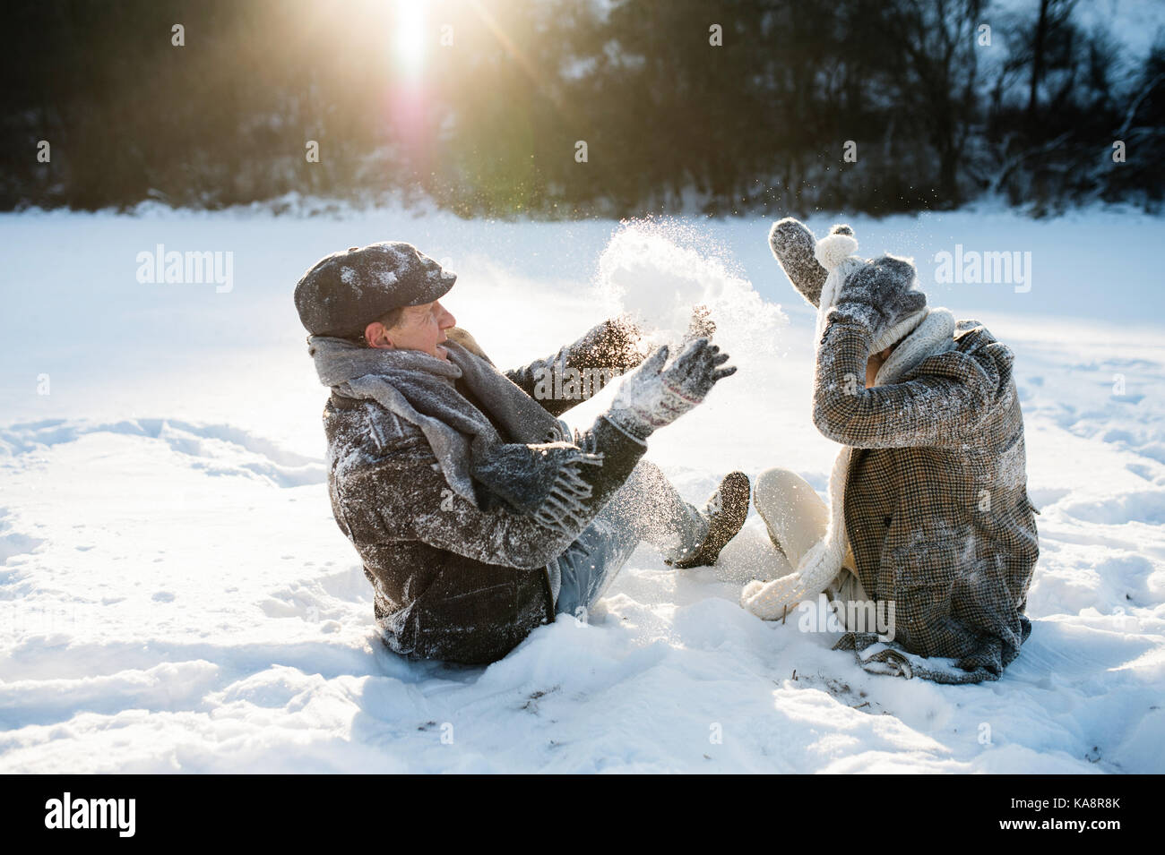 Beautiful senior couple in sunny winter nature. Stock Photo