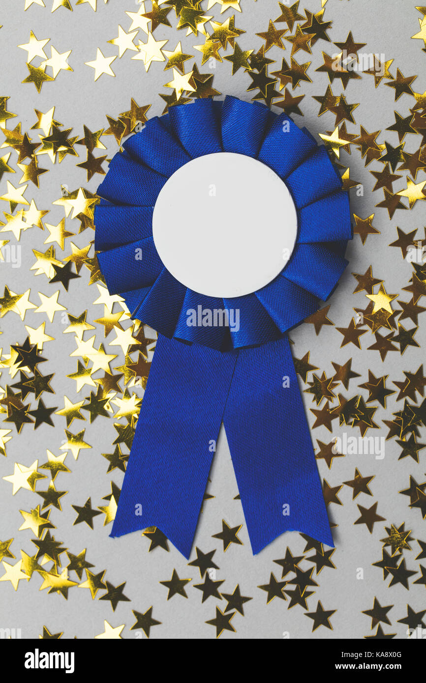 First place award rosette with gold stars. Success achievement concept - Stock Image