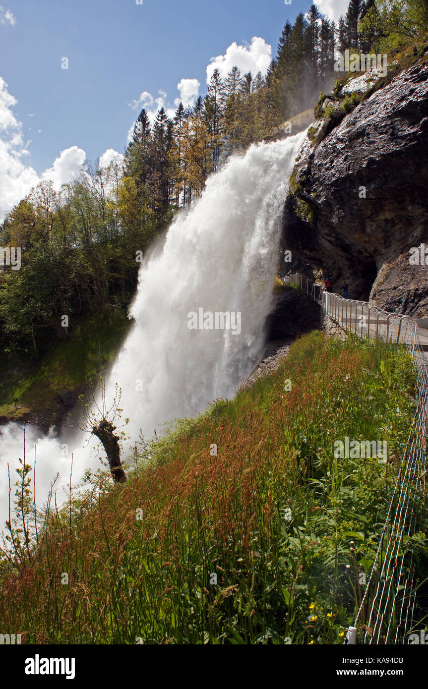 Steinsdalsfossen waterfall in the river of Steine, scenic landscape with cascade surounded by mountains and rocks - Stock Image