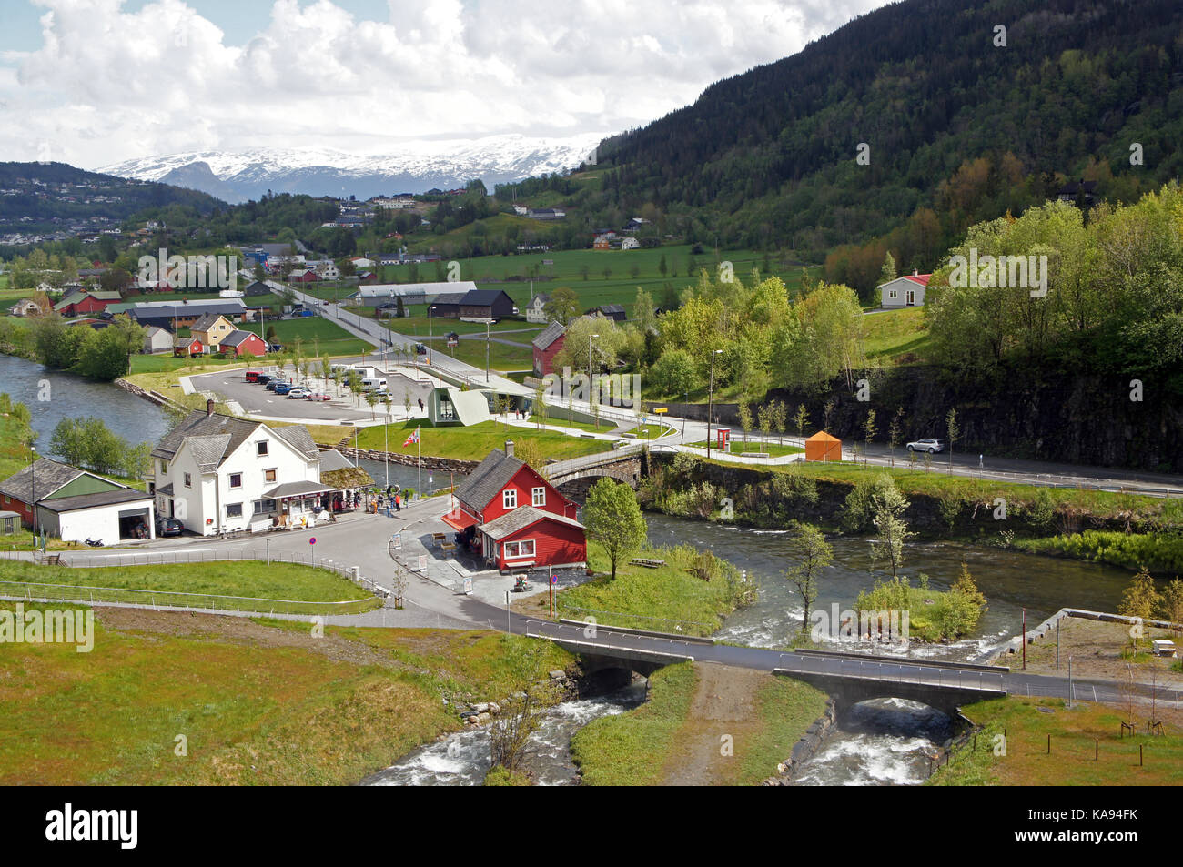 View from Steinsdalsfossen waterfall at the river of Steine, scenic landscape with cascade surounded by mountains - Stock Image