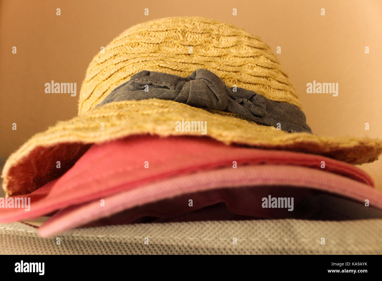 Pille of little girl hats in closeup Stock Photo