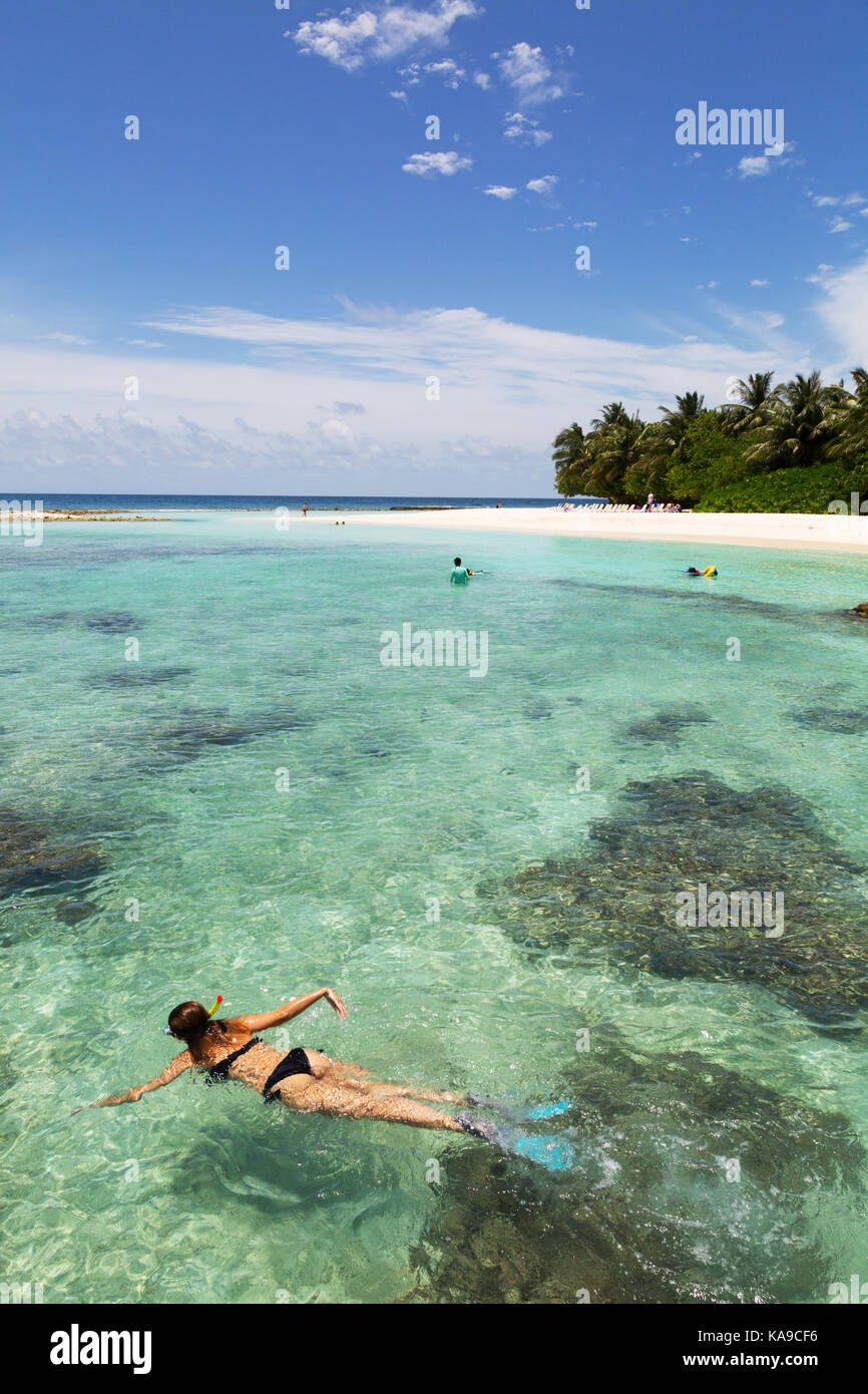maldives-a-woman-snorkeling-in-the-india