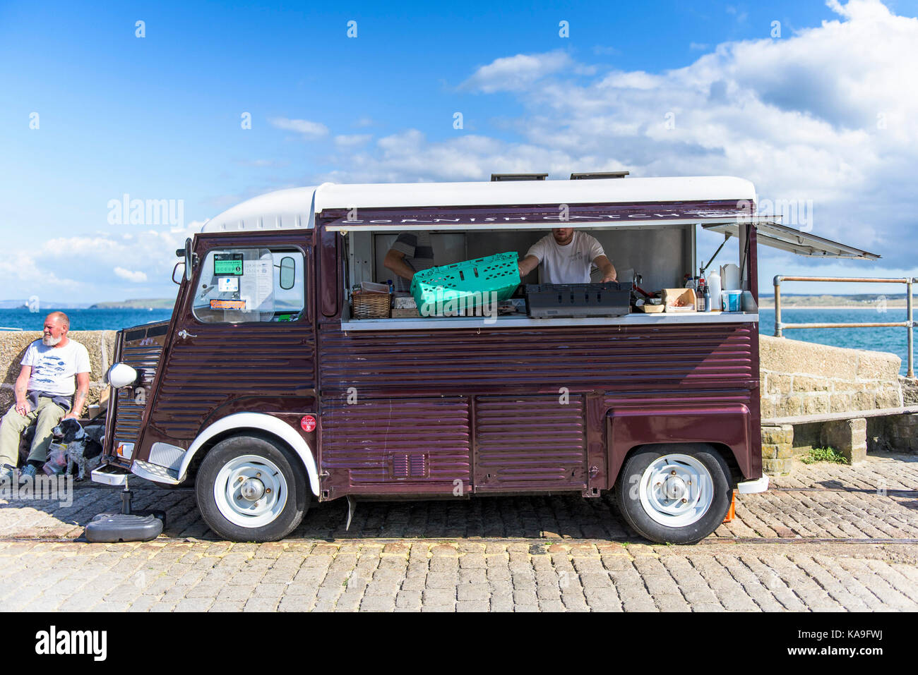 Catering truck - a classic vintage Citroen catering van parked on Smeatons Pier in st Ives in Cornwall. - Stock Image
