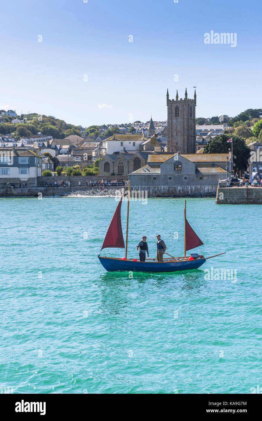 St Ives - a small ketch sailing in St Ives Harbour in St Ives in Cornwall. - Stock Image