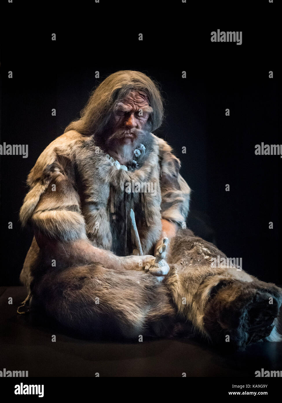 Berlin. Germany. Model of a Late Stone Age Man (Upper Paleolithic) ca. 30,000 BC, with Venus from Dolní Věstonice, - Stock Image
