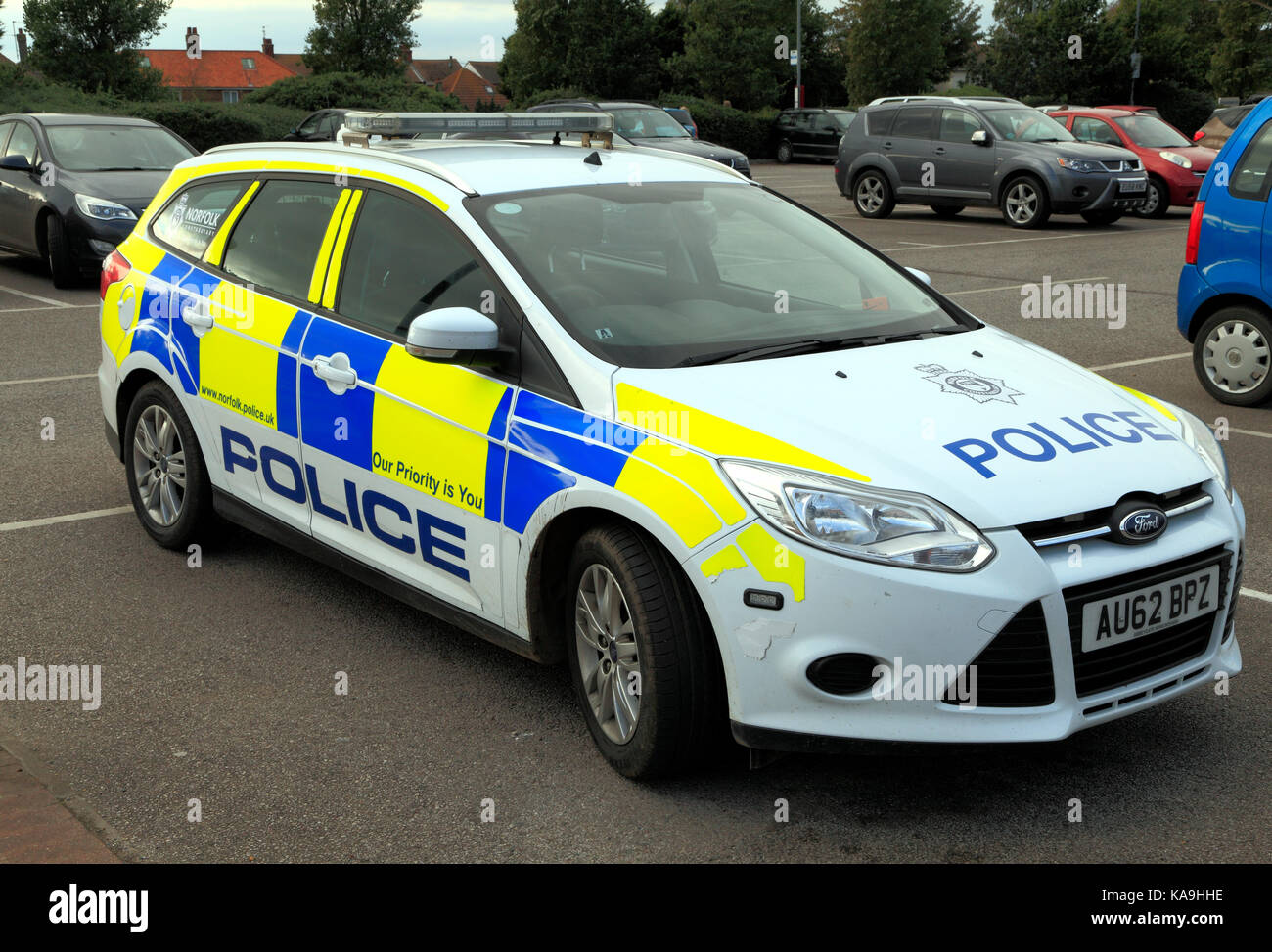 Police Car, UK, badly parked, overhanging parking bay, Norfolk Constabulary, vehicle, vehicles, cars, England, UK - Stock Image