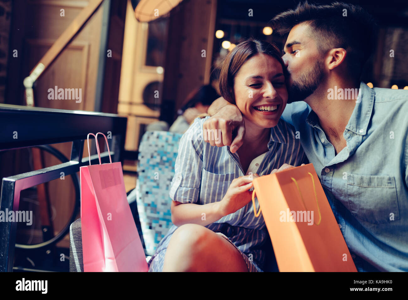 Young attractive couple on date in coffee shop - Stock Image