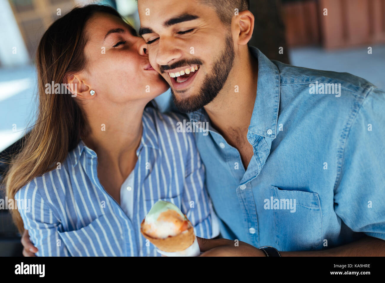 Happy couple having date and eating ice cream - Stock Image