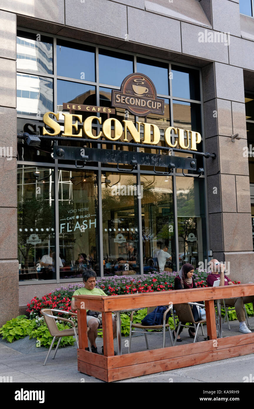 People sitting outside the Second Cup coffee shop on McGill College Avenue in downtown Montreal, Quebec, Canada - Stock Image