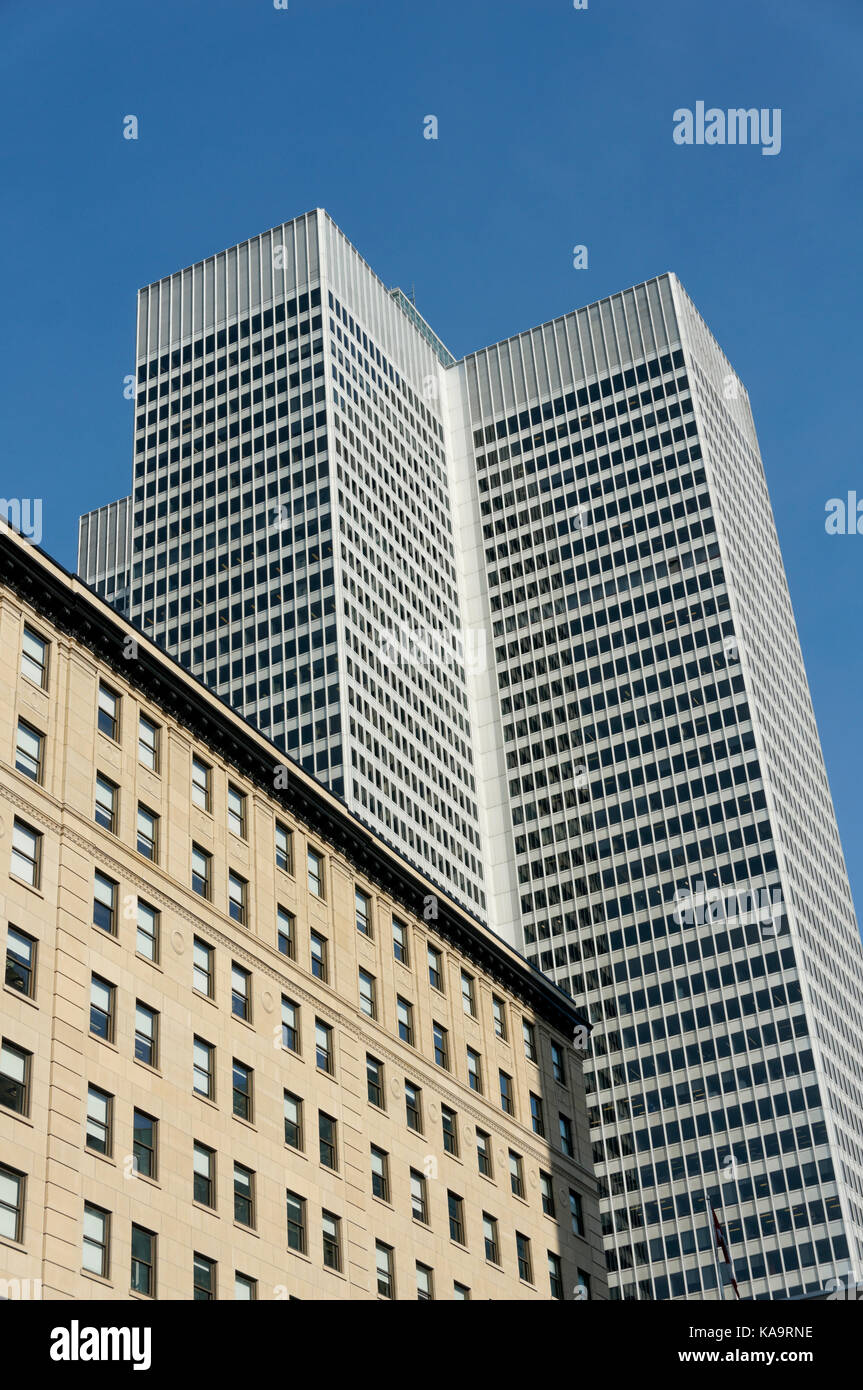 Confederation Building and Place Ville Marie office tower from McGill College Avenue in downtown Montreal, Quebec, Stock Photo