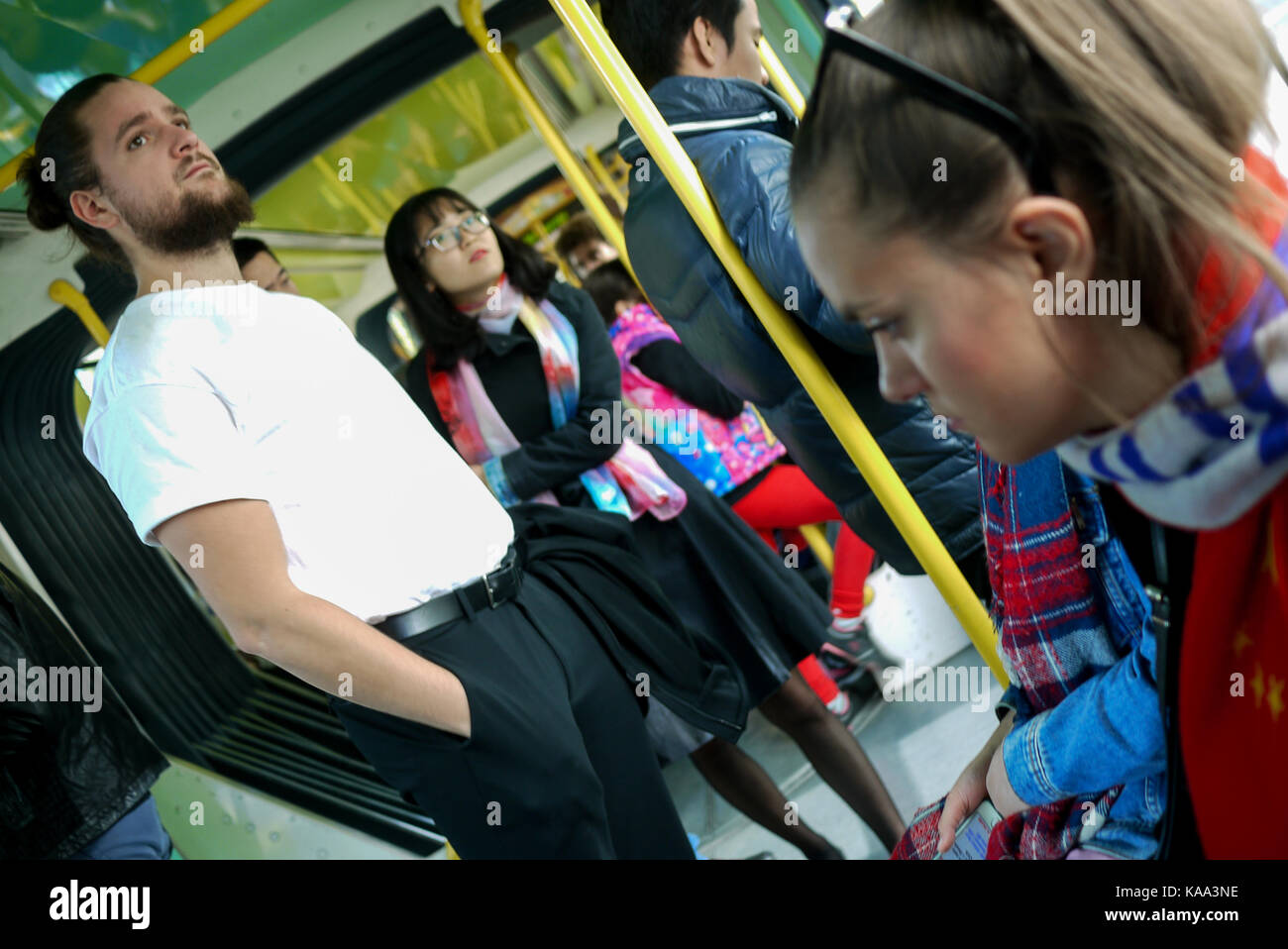 Young people in a T3 tramway wagon, Paris, France - Stock Image
