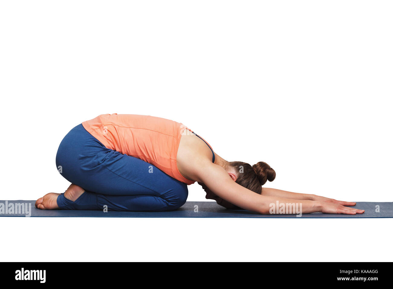 Woman relax in Hatha yoga asana Balasana child pose - Stock Image