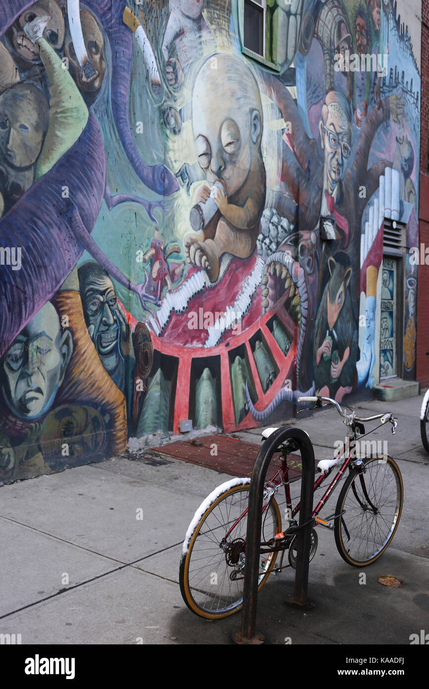BROOKLYN, NEW YORK, USA - MARCH 2017 - Graffiti and a locked bike in williamsburg, NY - Stock Image