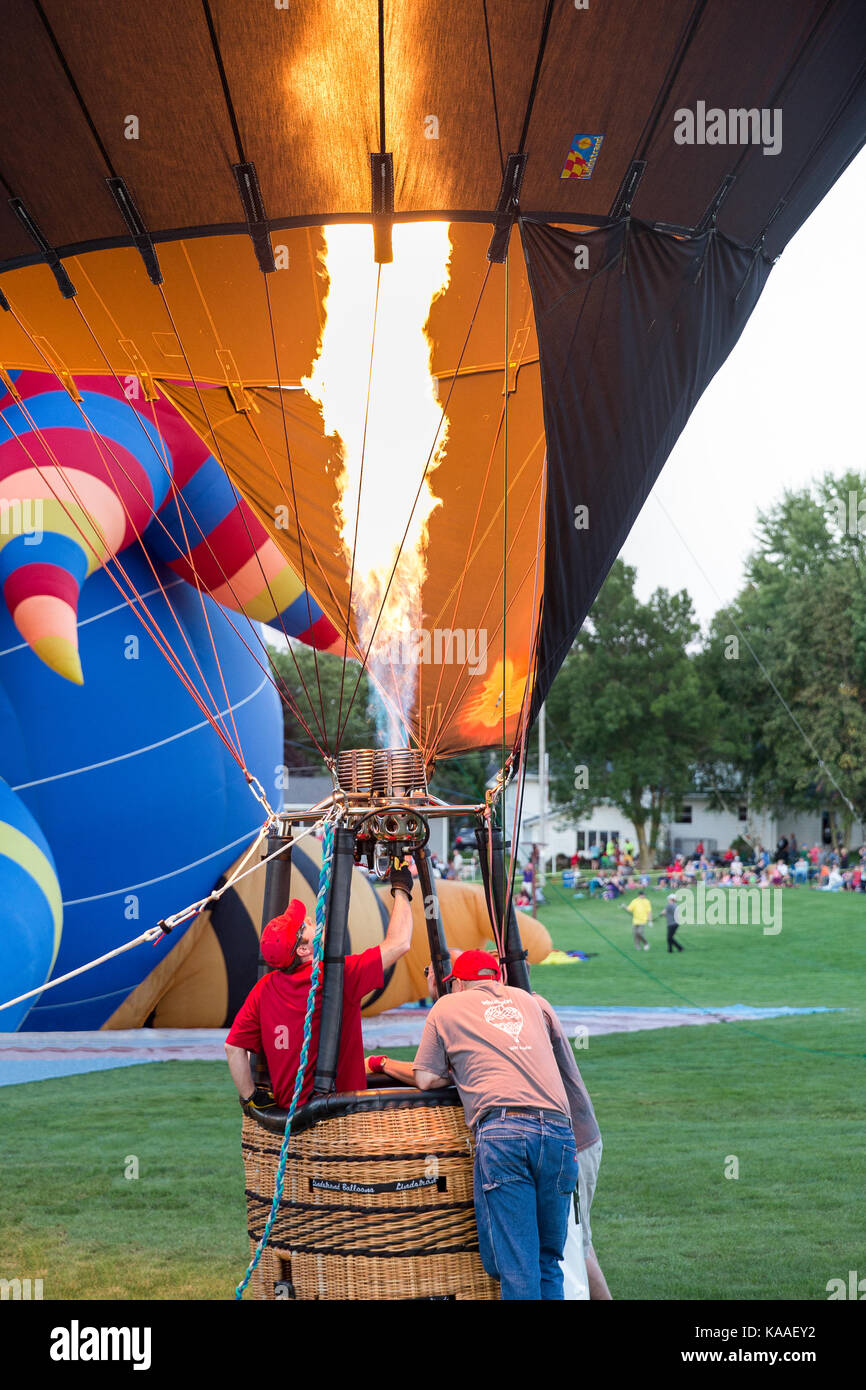 Seymour, WI - August 12, 2017:  Hot air balloon crew preparing for launch during Hamburger Fest in Seymour, WI.  Hot air balloons are an integral part Stock Photo