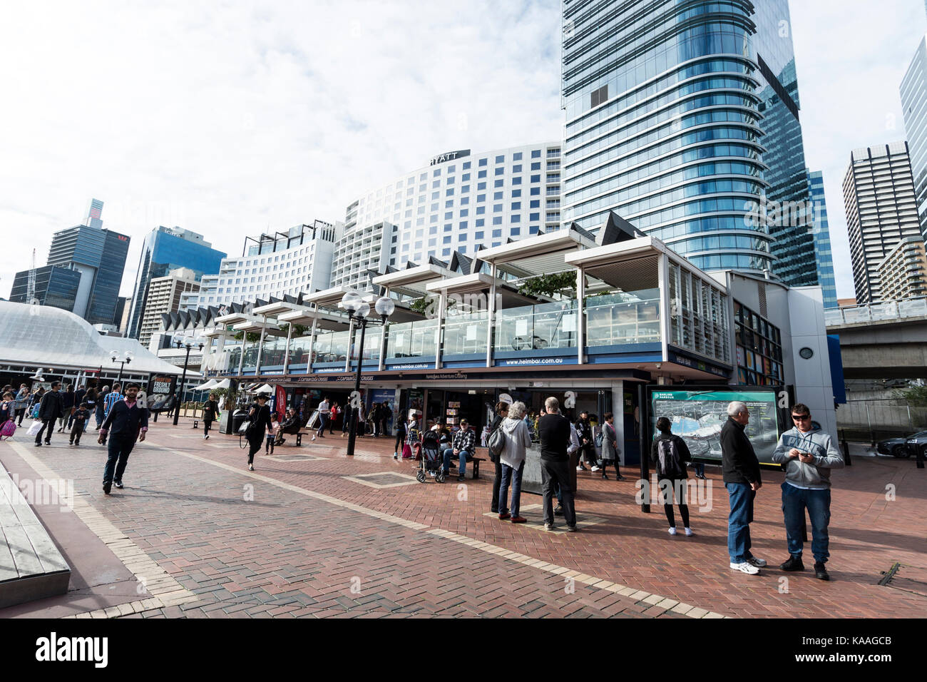 The Promenade with a variety of eateries, large corporate businesses and tourist attractions at Darling Harbour - Stock Image