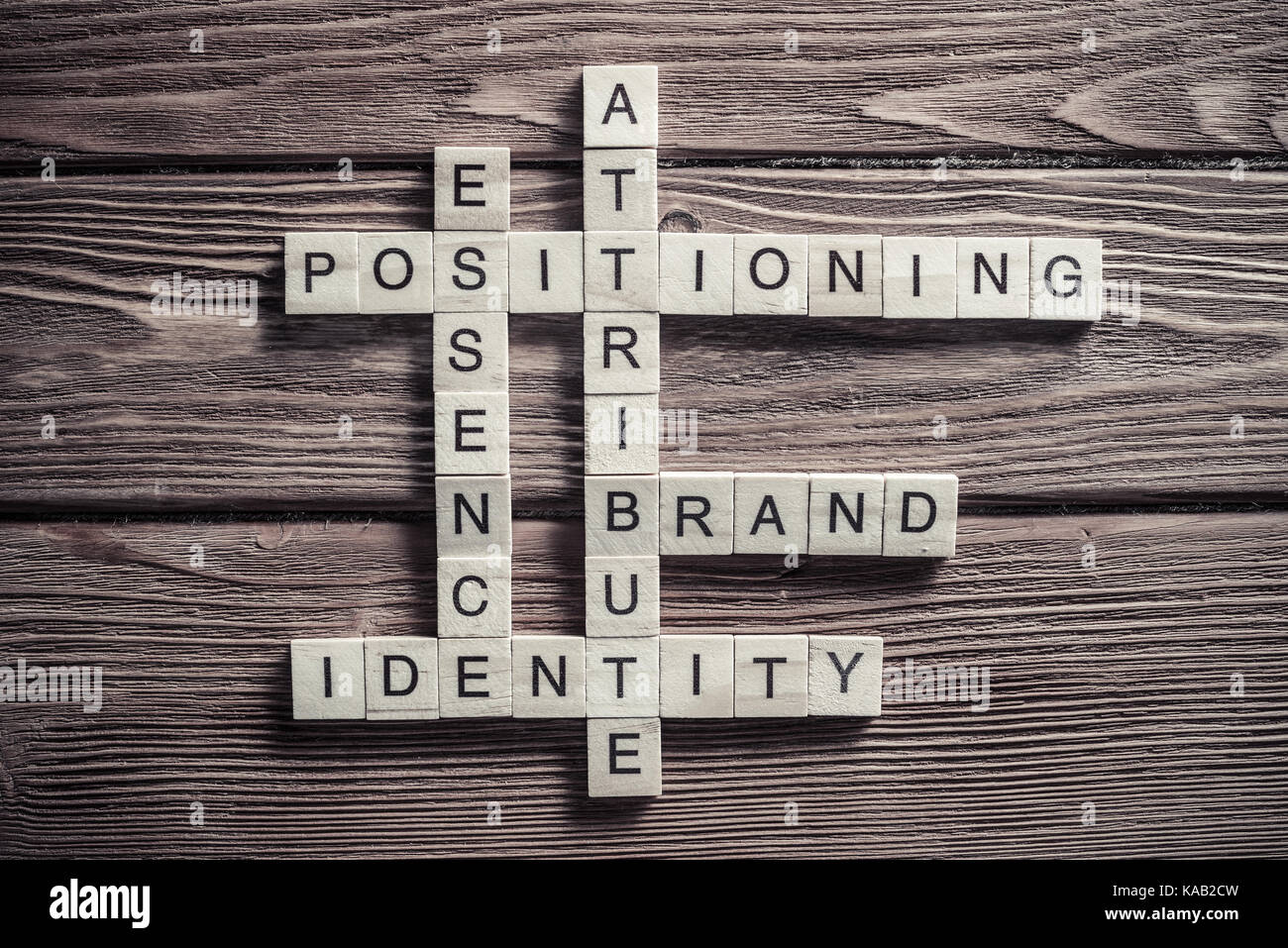 Conceptual business keywords on table with elements of game maki - Stock Image