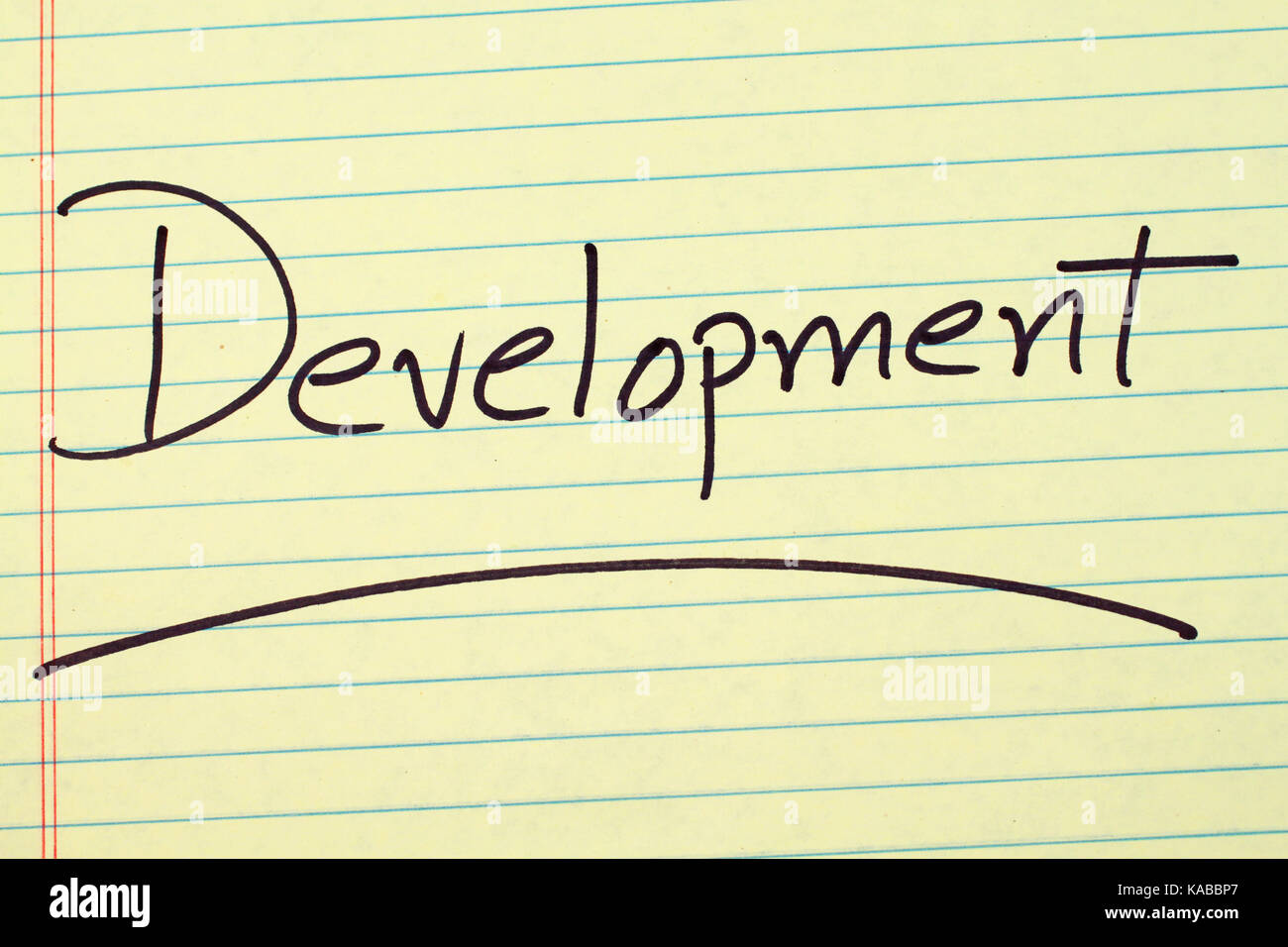 """The word """"Development"""" underlined on a yellow legal pad Stock Photo"""