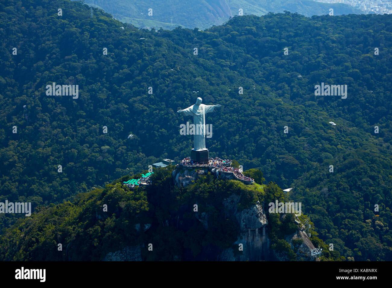 Giant statue of Christ the Redeemer atop Corcovado, Rio de Janeiro, Brazil, South America - aerial - Stock Image