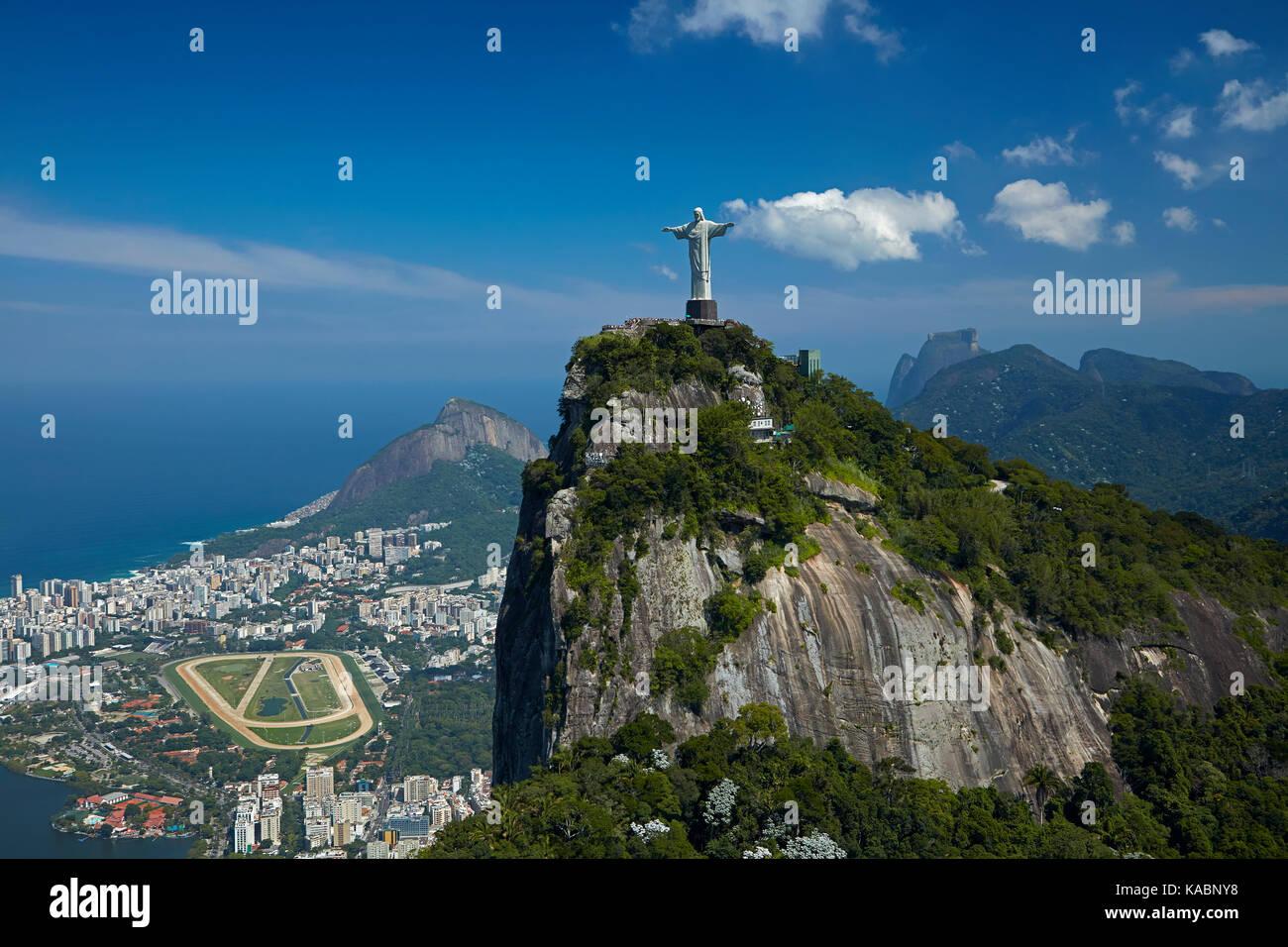 Christ the Redeemer atop Corcovado, and Jockey Club Brasileiro, Rio de Janeiro, Brazil, South America - aerial Stock Photo