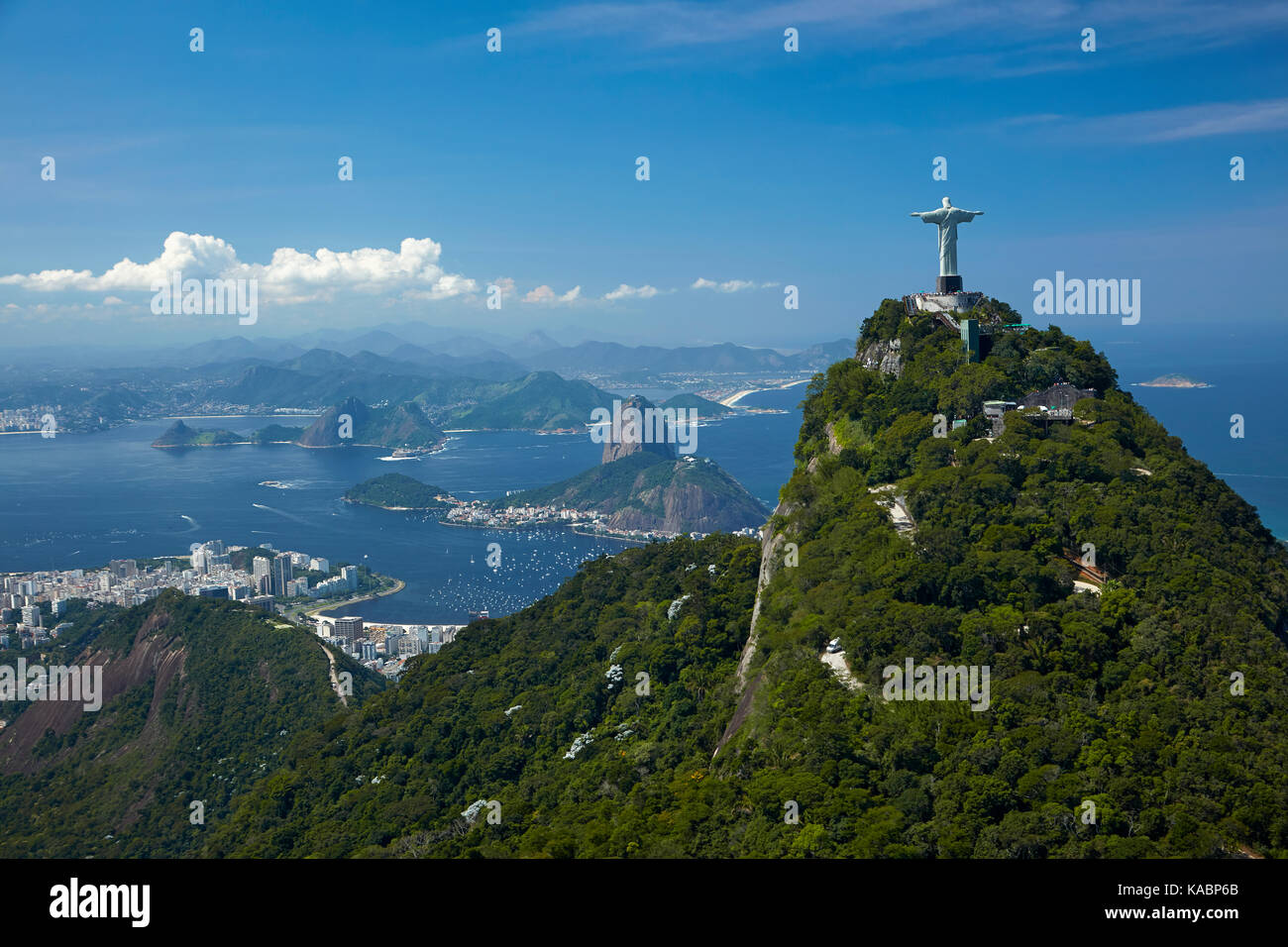 Christ the Redeemer statue atop Corcovado, and Sugarloaf Mountain, Rio de Janeiro, Brazil, South America - aerial - Stock Image
