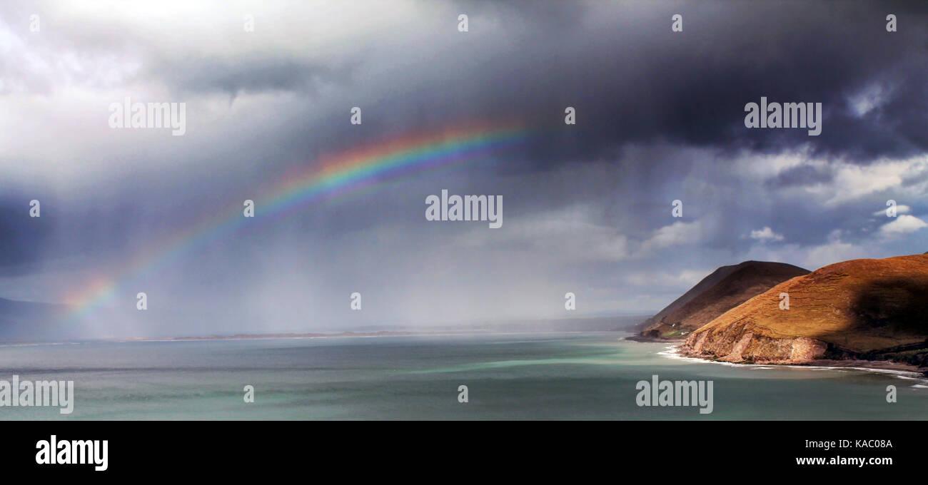 Rainbow over the wild atlantic way, County Kerry, Ireland - Stock Image