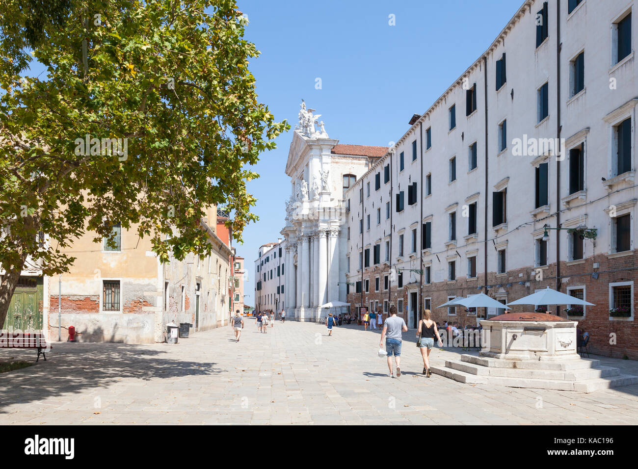View of Campo dei Gesuiti, Cannaregio, Venice, Italy with  a few tourists walking towards the Gesuiti Church and - Stock Image