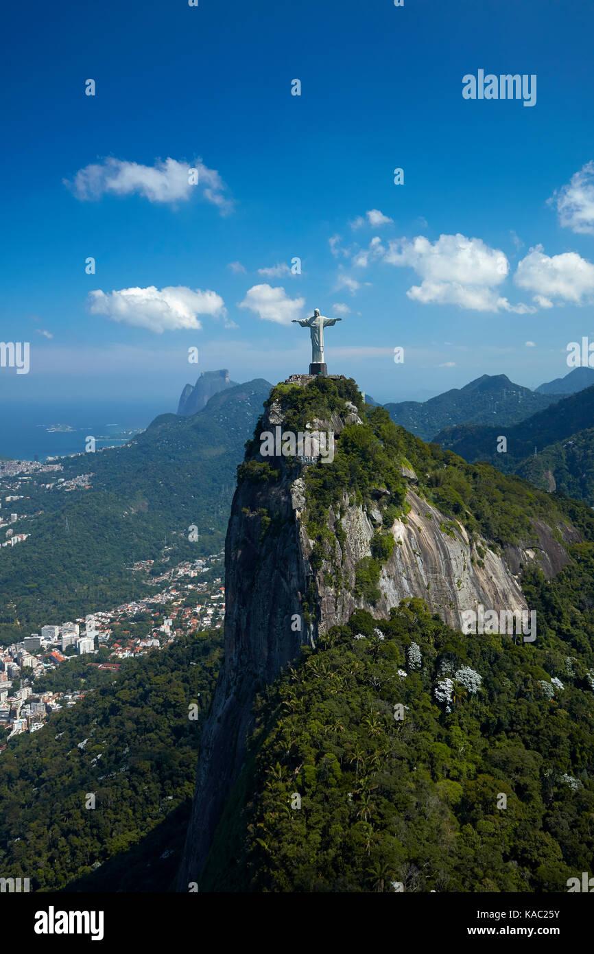 Christ the Redeemer statue atop Corcovado, Rio de Janeiro, Brazil, South America - aerial - Stock Image
