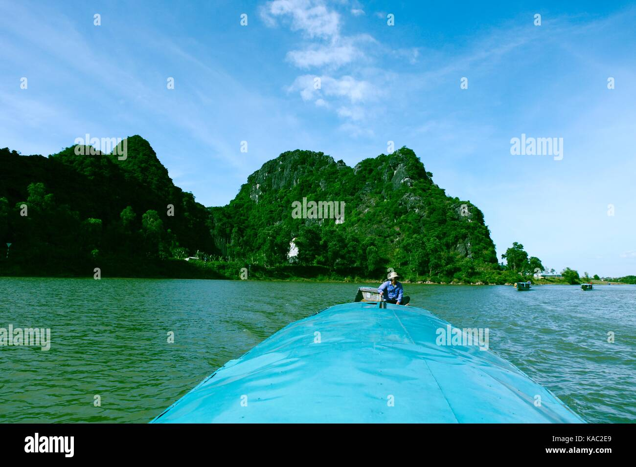 QUANG BINH, VIETNAM - AUGUST 11, 2017: Amazing natural landscape at Quang Binh, Viet Nam on day, boat moving on - Stock Image