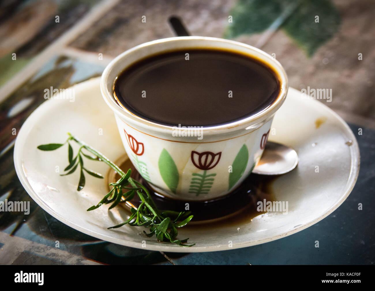 Traditional ethiopian coffee set with Ruta graveolens herb, Jinka, Ethiopia - Stock Image