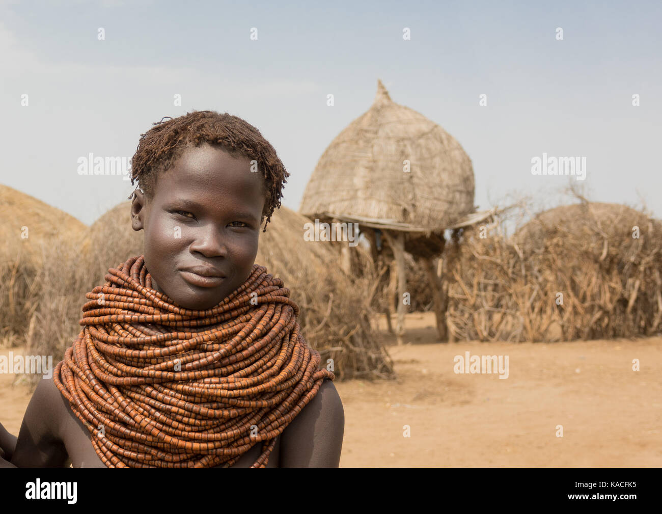 Young Nyangatom woman in her village, Kangate, Omo Valley, Ethiopia Stock Photo