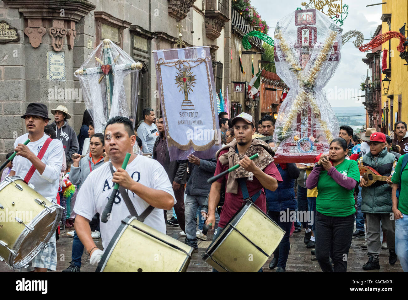 Residents carry crosses and religious icons in a procession through the Jardin Allende during the week long fiesta - Stock Image