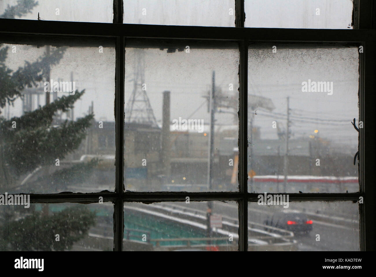 Cloudy winter day in an industrial area, viewed through office window of former E B Eddy paper mill, Ottawa, Canada, Stock Photo