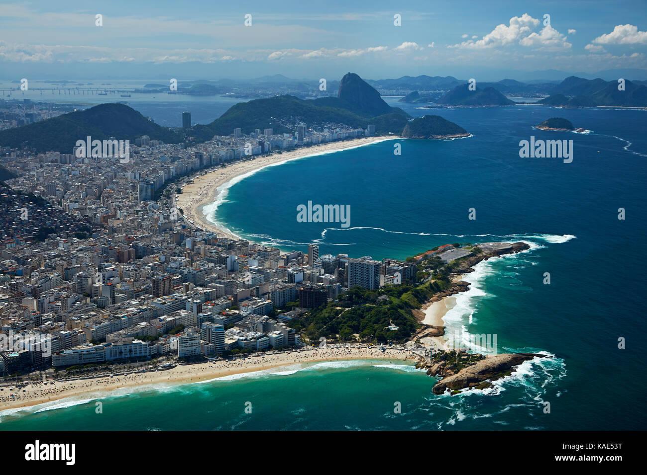 People on Ipanema Beach, and Copacabana Beach (top), Rio de Janeiro, Brazil, South America - aerial Stock Photo